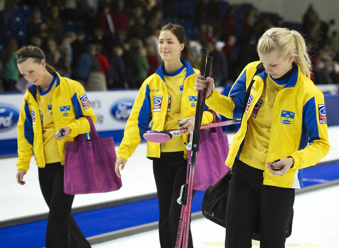 Sweden's Ostlund leaves the ice with Lennartsson and Carlsson after they lost the bronze medal game to Canada during the World Women's Curling Championships in Swift Current.