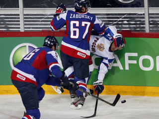 Russia's Mozyakin fights for the puck with Slovakia's Mihalik and Zaborsky during their 2013 IIHF Ice Hockey World Championship preliminary round match at the Hartwall Arena in Helsinki