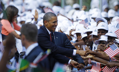 U.S. President Obama and the First lady are greeted during an official arrival ceremony in Dar Es Salaam