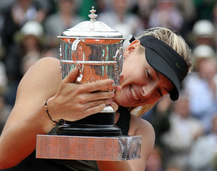 Sharapova of Russia holds the trophy as she poses during the ceremony after defeating Errani of Italy during their women's singles final match at the French Open tennis tournament at the Roland Garros stadium in Paris
