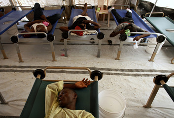 Haitians with cholera wait for treatment at a improvised clinic run by Doctor without Borders in Port-au-Prince