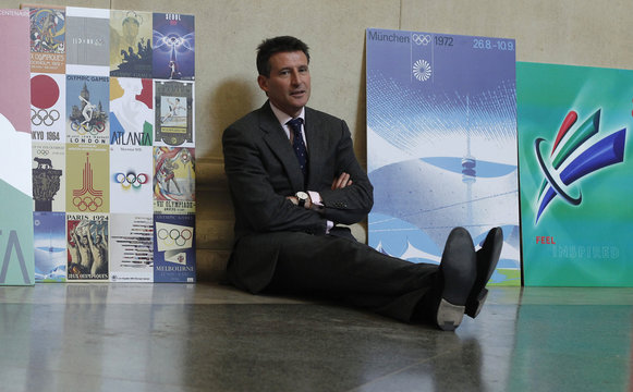 Sebastian Coe, chairman LOCOG poses with vintage Olympic posters at Tate Britain in London