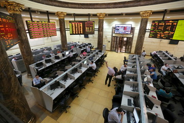 File photo of traders working at the Egyptian stock exchange in Cairo