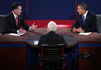 U.S. President Obama listens as Republican presidential nominee Romney speaks during the final presidential debate in Boca Raton