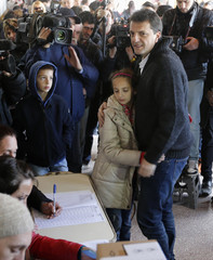 Massa, major of Buenos Aires' Tigre town, waits to vote at a polling station in Tigre