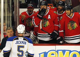 St. Louis Blues' Barret Jackman is taunted by by Chicago Blackhawks players during the second period of their NHL hockey game in Chicago, Illinois