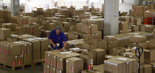 An employee seals boxes containing packed vinyl records created at the GZ Media factory in Lodenice
