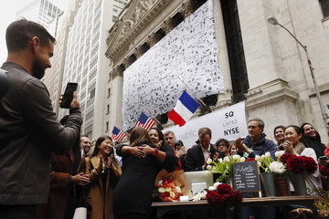 Jack Dorsey, CEO of Square and CEO of Twitter, live casts video of his mother as she hugs a vendor after using her Apple watch to make a purchase with a Square reader outside the New York Stock Exchange for the IPO of Square Inc., in New York