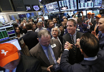 Bill Day, CEO of Tremor Video, and company executives ring the opening bell to celebrate their company's IPO at the New York Stock Exchange