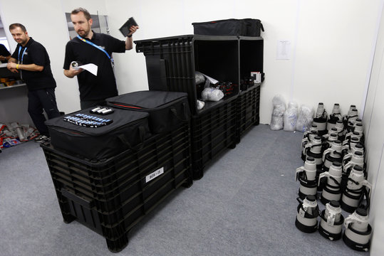 Canon Professional Service representative Mike Burnhill sorts out loan camera gear as they open their support center at the media area of the Arena de Sao Paulo World Cup stadium in Sao Paulo