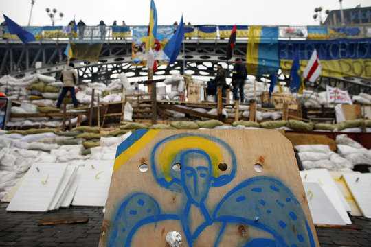 A spray-painted icon in the colours of the Ukrainian flag is placed on a barricade during a rally in Independence Square in Kiev