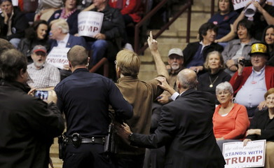 Police and security personnel remove a protester as U.S. republican presidential candidate Donald Trump speaks during a campaign event in Rock Hill