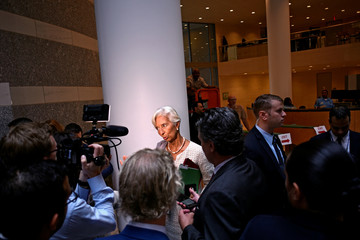 IMF Managing Director Christine Lagarde speaks to reporters at the annual meetings of the IMF and World Bank Group in Washington