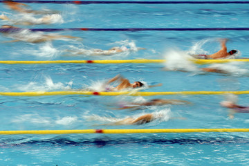 Swimmers swim at Munhak Park Tae-hwan Aquatics Center during a practice session for the swimming competition for the 17th Asian Games in Incheon