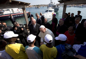 Pope Francis talks with migrants at Lampedusa Island