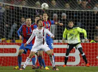 Pato of AC Milan heads a ball as Viktoria Plzen's Bystron, Pilar, Cisovsky and goal keeper Cech look on during their Group H Champions League match in Prague
