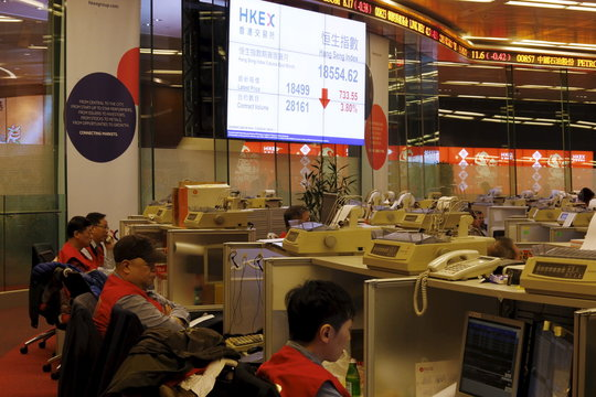 A display board shows the falling Hang Seng Index during morning trading on the first day of trading after Lunar New Year holidays at the Hong Kong Stocks Exchange