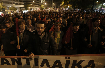 Protesters from the communist-affiliated trade union PAME march during a rally in central Athens