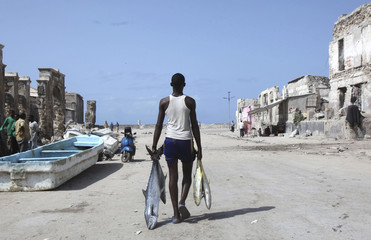 A man carries fishes from the shores of the Indian ocean in Mogadishu