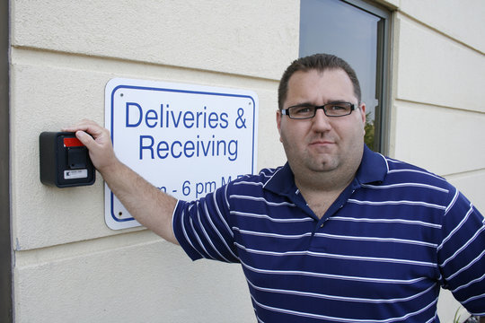 Judd Saul of the Cedar Valley Tea Party, showing off a lockbox at the back of his family's restaurant containing keys to his business for the event of an emergency in Cedar Falls