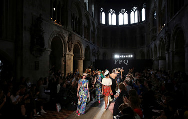 Models present creations at the PPQ catwalk show during London Fashion Week Spring/Summer 2017 in London