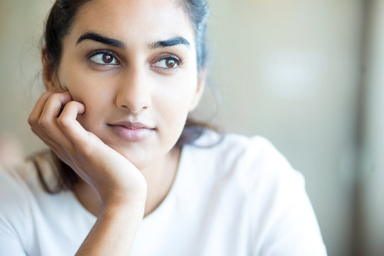 Dreamful Indian girl thinking of future