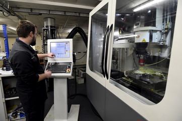A machine operator works at FSG Tool and Die Limited in LLantrisant