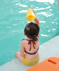 Little girl in swimming pool training.