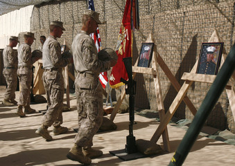 U.S. Marines pay tribute to comrades who lost their lives during February's Marjah offensive, at camp Sharwali, Marjah district