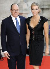 Prince Albert of Monaco and Charlene Wittstock arrive for the private viewing of the Grace Kelly exhibition at the Victoria and Albert Museum in London