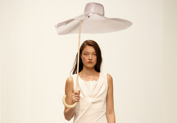 A model presents a creation by designer Hussein Chalayan as part of his Spring/Summer 2014 women's ready-to-wear fashion show in Paris