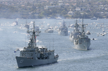 Royal Australian Navy warships led by HMAS Sydney enter Sydney Harbour as part of the International Fleet Review celebrations