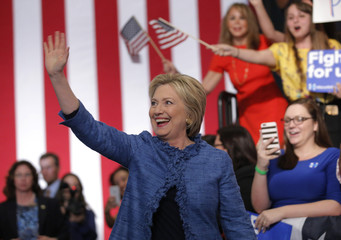 Democratic U.S. presidential candidate Hillary Clinton waves as she arrives to speak to supporters at a campaign rally in West Palm Beach
