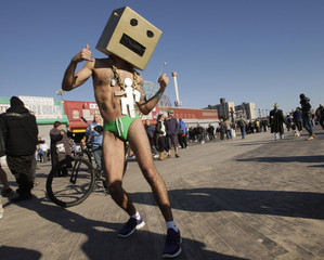 A reveler poses for a picture as he takes part in the Coney Island