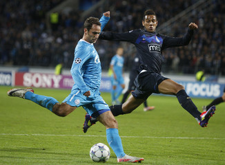 Zenit St. Petersburg's Shirokov fights for the ball with Porto's Souza during their Champions League Group G soccer match in St. Petersburg