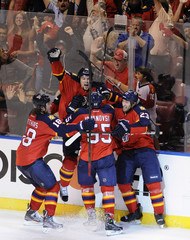 Florida Panthers' Upshall celebrates his goal against the New Jersey Devils with his teammates during the third period of their NHL Eastern conference quarterfinal playoff hockey Game 5 in Sunrise