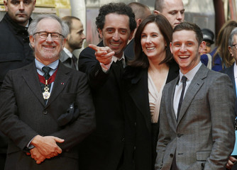 Director Spielberg, producer Kennedy and actors Elmaleh and Bell wait for the launch of a Tintin Thalys high-speed train in Brussels