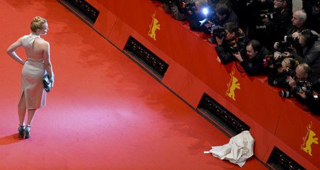 Actress Dragus arrives on the red carpet for the awards ceremony of the 64th Berlinale International Film Festival in Berlin
