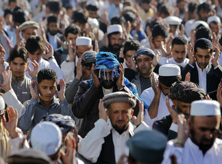 Afghan men pray during Eid al-Adha prayers in Kabul