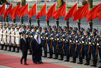 Sabah and Li inspect an honour guard during an official welcoming ceremony at the Great Hall of the People in Beijing,