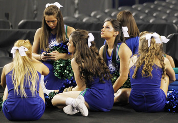 Florida Gulf Coast Eagles cheerleaders sit after their team's loss to the Florida Gators in their South Regional NCAA men's basketball game in Arlington