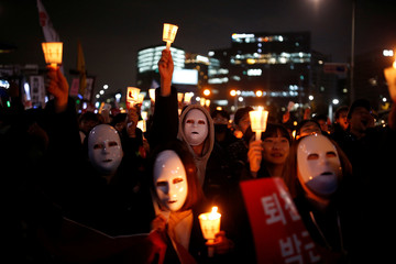 People march toward the Presidential Blue House during a rally demanding President Park Geun-hye to step down  in central Seoul