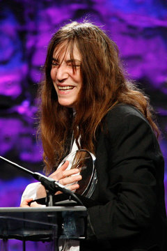 Rock icon Patti Smith clutches her Founders Award at the 27th annual ASCAP Pop Music Awards in Hollywood