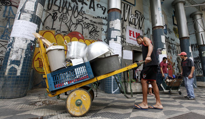 A man from Brazil's Movimento dos Sem-Teto, pushes a cart with some items from the community kitchen in downtown Sao Paulo