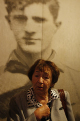 Warsaw ghetto survivor Aliza Melamed stands in front of a picture of Mordechai Anielewicz at the museum in Kibbutz Yad Mordechai