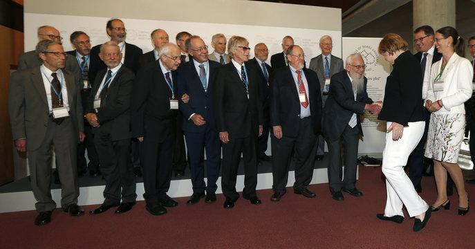 German Chancellor Merkel welcomes international Nobel Laureates before opening ceremony of Lindau Nobel Laureate Meetings on Economic Sciences in Lindau