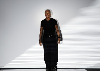 Italian designer Armani acknowledges applause at the end of his Emporio Armani Fall/Winter 2010/11 Men's collection during Milan Fashion Week