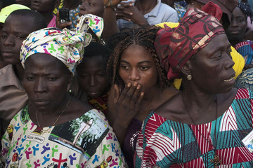 The crowd waits for Pope Benedict XVI to pass by on the street in Benin's main city Cotonou