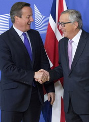 British Prime Minister Cameron is welcomed by European Commission President Juncker in Brussels