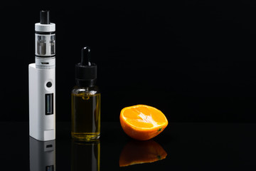 White electronic cigarette on a black background, next to the mandorin gum for filling